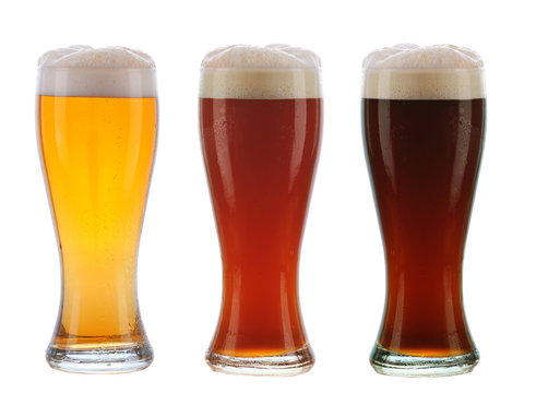 Three Different beer in Galsses with Foamy Tops