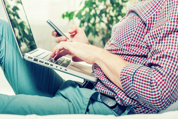 elegant business multitasking multimedia man using devices at home