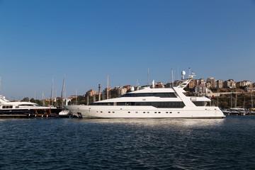 Large luxury white yacht on the port