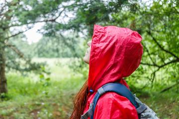 Side view of woman in hood
