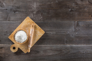 Cup of flour and cutting board