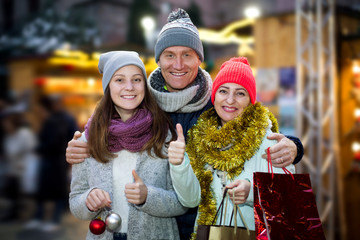 Ordinary parents with teen girl in market