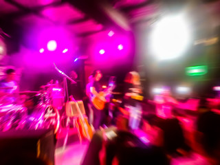 The live music Room39 scene of the pop band is very popular with the audience. Concert pictures at night time. Abstract photo blur