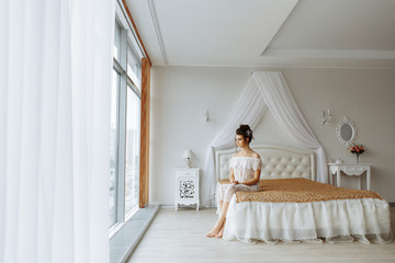 Woman in chic underwear, luxury bedroom interior