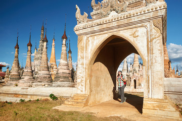 Traveler walking along from the Buddhist stupas temple complex in Myanmar