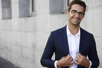 Sharp suited businessman in glasses, portrait