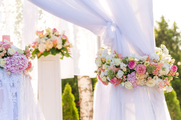 floral wedding decorations pink and white. Garland, candle, lace, bouquet