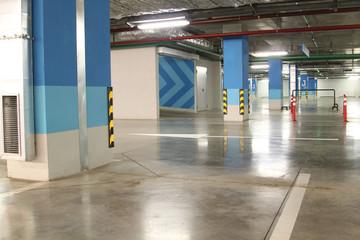 Empty parking garage underground interior in apartment or in supermarket
