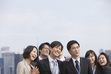 Smiling Businessman and Businesswoman Under Blue Sky