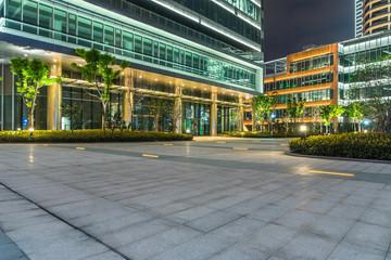 night view of empty brick floor front of urban building