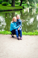 Mother and daughter are walking in the Park