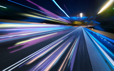 Moving forward motion blur background with light trails ,night scene . Wall mural