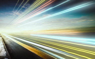 Wall Mural - Moving forward motion blur background with light trails ,evening scene .