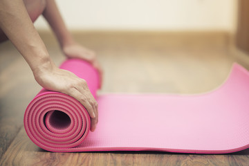 Foto op Textielframe School de yoga Young woman holding a yoga mat in exercise class for a sport and healthy concept