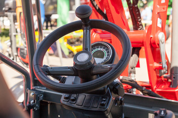 Close up of modern tractor steering wheel