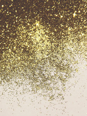 Beautiful blurry golden background with glitter