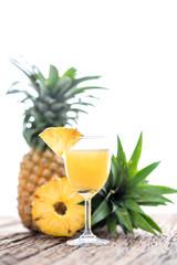 Glass of pineapple juice onwood table