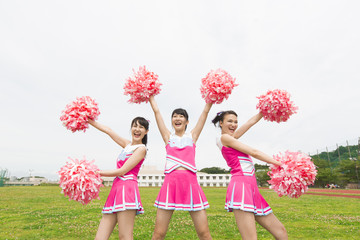 Three Cheerleaders  Cheering with Pom Pom