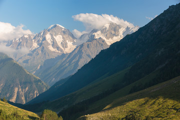 Russia, Republic of Kabardino-Balkaria, time lapse. Summer in the mountains of the Caucasus. Formation and movement of clouds over mountains peaks.