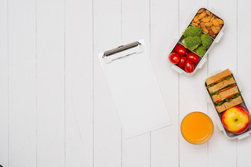 Diet breakfast on desk with blank paper and pen on table