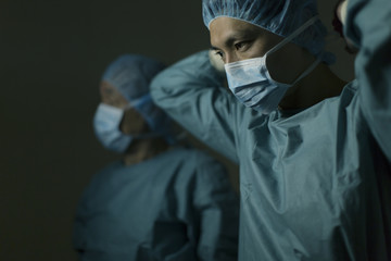 Male doctors getting ready for surgery