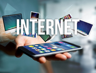 Internet title surounded by device like smartphone, tablet or laptop - Internet and communication concept