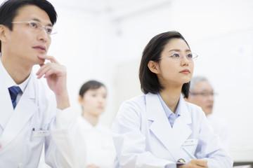 Doctors attending presentation in meeting room