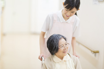 Nurse and patient in wheelchair