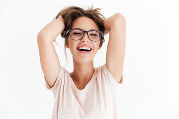 Laighing woman in eyeglasses holding her hair