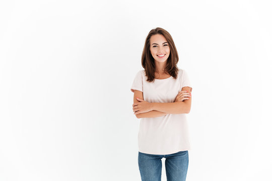 Smiling brunette woman with crossed arms looking at the camera