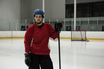 Portrait of ice hockey player at rink