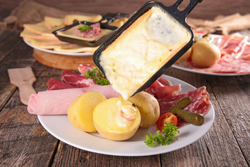 raclette cheese melted on potato