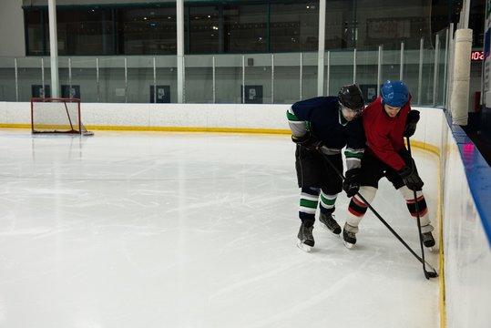Male players playing ice hockey