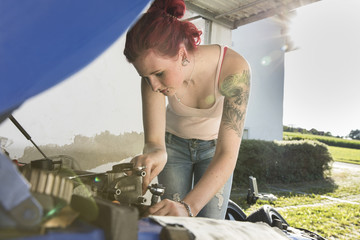 Young woman checking engine