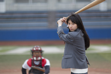 The female student who does the style struck with a baseball bat