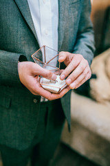picture of man with glass decorated gift box and wedding ring