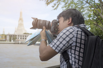 Asian tourist and photographer take photo at Wat Arun Temple  in bangkok Thailand.