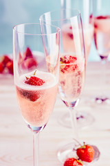 Delicious pink champagne with fresh strawberries
