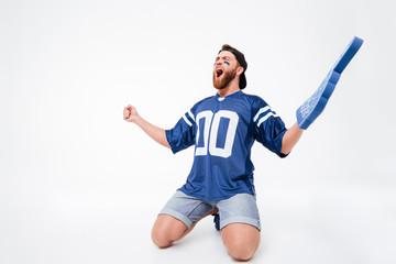 Excited screaming man fan wearing number one fan glove finger.
