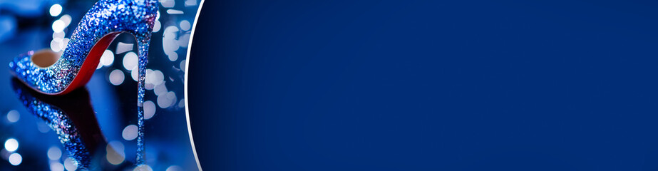 High heels pumps with diamonds on deep blue background. Fashion banner with shoes.