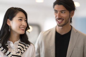 Profile of man and woman smiling