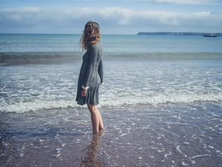 Young woman standing on the beach