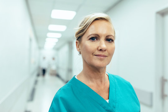 Female healthcare worker standing in hospital corridor