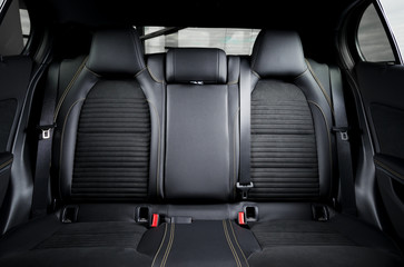 Modern car race interior, black leather with yellow stitch, back seats