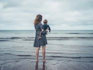 Mother with baby looking at the sea