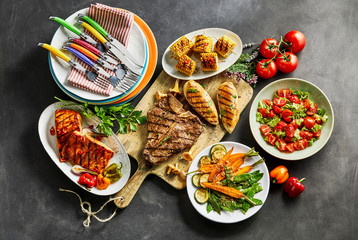 Assorted gourmet meat, foods and dining crockery