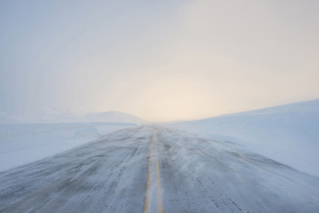 View of snow covered road against sky during foggy weather