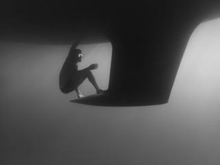 Side view of man swimming by keel undersea