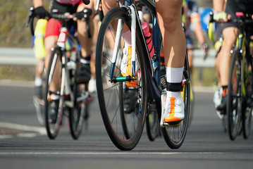 Cycling competition,cyclist athletes riding a race,detail cycling shoes