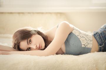 sad sensual girl lying at sunlight, toned image